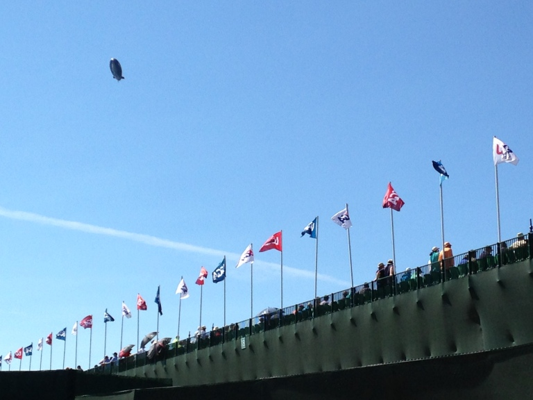 Why, yes, that is the Goodyear blimp!  The flags were on the back of the giant grandstand at the 18th hole.